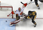 Pittsburgh Penguins' Evgeni Malkin (71) gathers the puck and prepares to put it behind Calgary Flames goaltender Jon Gillies (32) for a goal in the first period of an NHL hockey game in Pittsburgh, Monday, March 5, 2018. (AP Photo/Gene J. Puskar)