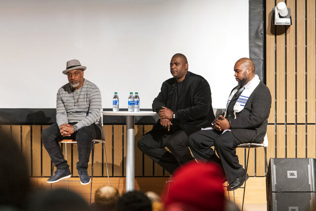 William Moore, left, Anthony Wilson, center, and Jeffrey Wilson, right, speak at a conversation and private screening of