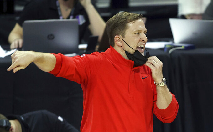 UNLV coach T.J. Otzelberger gestures during the second half of the team's NCAA college basketball game against Air Force in the first round of the Mountain West Conference men's tournament Wednesday, March 10, 2021, in Las Vegas. (AP Photo/Isaac Brekken)