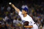 Los Angeles Dodgers relief pitcher Kenta Maeda, of Japan, throws during the eighth inning of the team's baseball game against the Miami Marlins on Friday, July 19, 2019, in Los Angeles. (AP Photo/Mark J. Terrill)