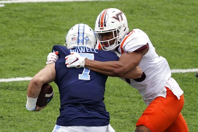 Virginia Tech linebacker Amare Barno rushes North Carolina quarterback Sam Howell (7) during the first half of an NCAA college football game in Chapel Hill, N.C., Saturday, Oct. 10, 2020. (AP Photo/Gerry Broome)
