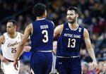Notre Dame's Nikola Djogo (13) and Prentiss Hubb (3) celebrate a basket during the first half of an NCAA college basketball game against Boston College in Boston, Saturday, Feb. 2, 2019. (AP Photo/Michael Dwyer)