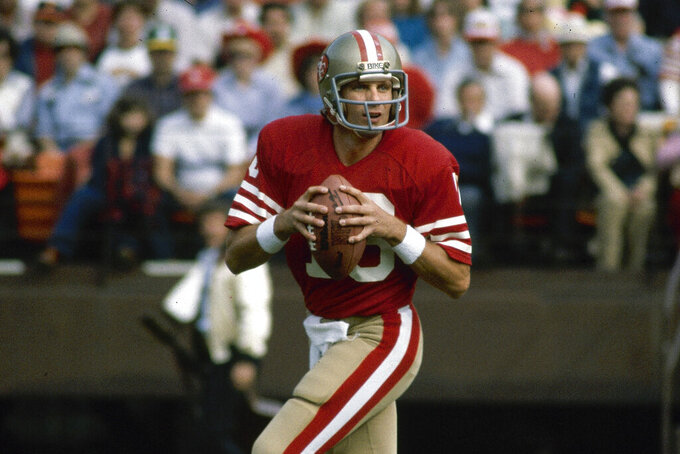 FILE - This is a 1981 file photo showing San Francisco 49ers NFL football quarterback Joe Montana. What doach Kyle Shanahan, quarterback Jimmy Garoppolo, defensive end Nick Bosa and the rest of the San Francisco 49ers are doing this year harkens back to 1981 when Bill Walsh, Joe Montana and Ronnie Lott led the franchise to its first Super Bowl title.  (AP Photo/File)