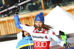 First placed Slovakia's Petra Vlhova celebrates at the end of an alpine ski, women's parallel slalom World Cup in St. Moritz, Switzerland, Sunday, Dec. 15, 2019. (AP Photo/Alessandro Trovati)