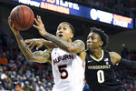 Vanderbilt guard Saben Lee (0) defends a drive to the basket by Auburn guard J'Von McCormick (5) during the second half of an NCAA college basketball game Wednesday, Jan. 8, 2020, in Auburn, Ala. (AP Photo/Julie Bennett)