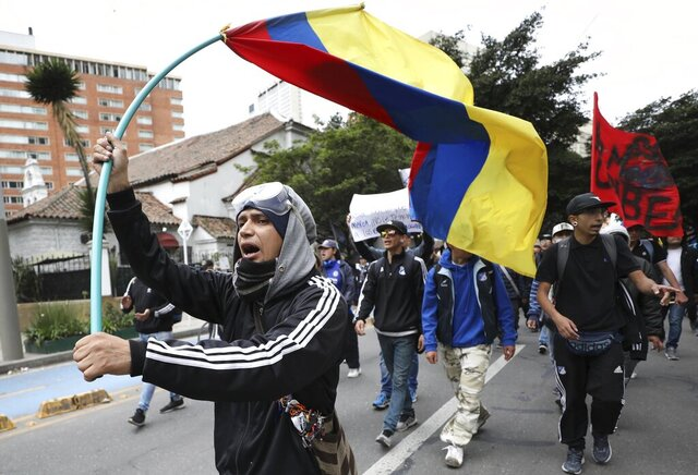 Anti-government demonstrators march during a protest in Bogota, Colombia, Wednesday, Nov. 27, 2019. Thousands of people have protested in Colombia over the past week, voicing discontent with the government of President Ivan Duque. (AP Photo/Fernando Vergara)