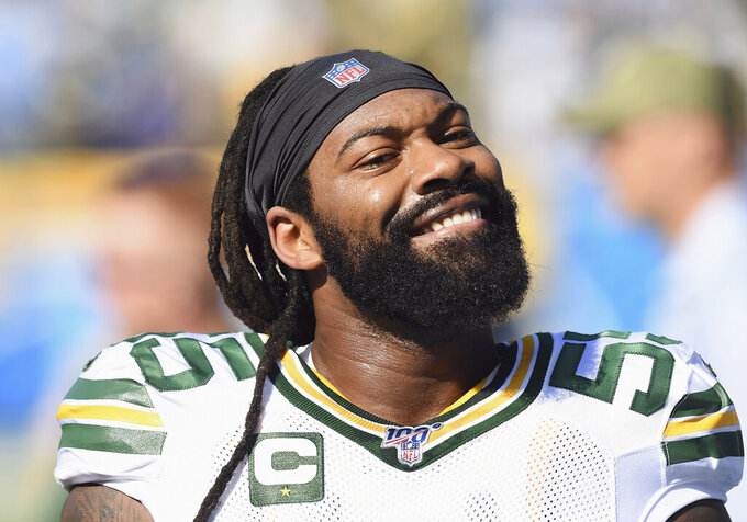 FILE - In this Sunday, Nov. 3, 2019, file photo, Green Bay Packers linebacker Za'Darius Smith (55) smiles towards the stands and a section of Packers fans before an NFL football game against the Los Angeles Chargers in Carson, Calif. Za'Darius Smith and Preston Smith aren't related, but the Packers pass rushers share the same last name and the same type of productive games. They combined for 25 ½ sacks last season after both signed with the Packers as free agents in early 2019.  (AP Photo/John Cordes, FIler)