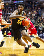 Purdue forward Trevion Williams (50) drives the ball toward the basket during the second half of an NCAA college basketball game against Indiana, Thursday, Feb. 27, 2020, in West Lafayette, Ind. (AP Photo/Doug McSchooler)