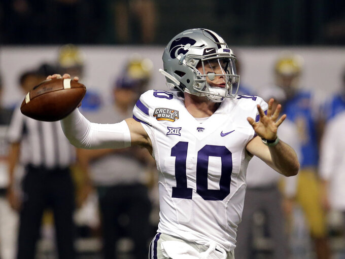 FILE - In this Dec. 26, 2017, file photo, Kansas State quarterback Skylar Thompson (10) throws down field against UCLA in the first half during an NCAA college football Cactus Bowl game, in Phoenix. Kansas State begins the season against South Dakota on Saturday night. The Wildcats return both of their starting quarterbacks and their entire offensive line, not to mention Hall of Fame coach Bill Snyder. (AP Photo/Rick Scuteri, File)