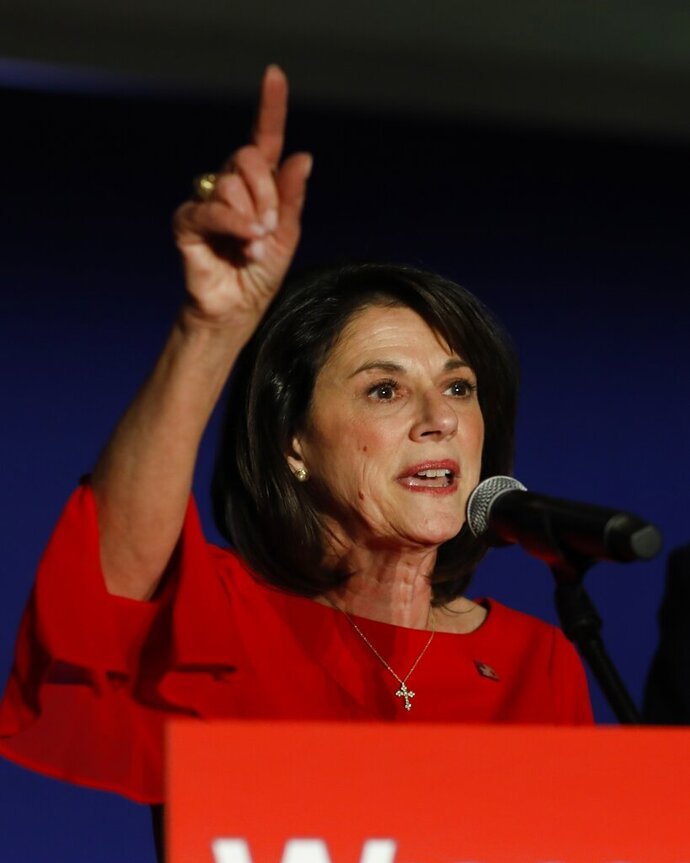 FILE - In this Nov. 6, 2018 file photo, Wisconsin Republican U.S. Senate candidate Leah Vukmir speaks at an election night event in Pewaukee, Wis. Potential Republican candidates have begun to jockey for position ahead of a likely stampede to run for an open Wisconsin congressional seat. Former state senator and 2018 Republican U.S. Senate nominee Leah Vukmir, along with current state Senate Majority Leader Scott Fitzgerald, both said they were seriously considering getting in the race. (AP Photo/Jeffrey Phelps, File)