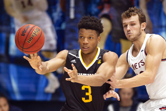Winthrop guard Micheal Anumba (3) passes away from defensive pressure by Saint Mary's guard Tanner Krebs (00) during the first half of an NCAA college basketball game, Monday, Nov. 11, 2019 in Moraga, Calif. (AP Photo/D. Ross Cameron)