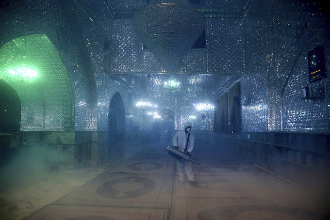 "A firefighter disinfects the shrine of Saint Saleh to help prevent the spread of the new coronavirus in northern Tehran, Iran, Friday, March, 6, 2020. A Health Ministry spokesman warned authorities could use unspecified ""force"" to halt travel between major cities. (AP Photo/Ebrahim Noroozi)"