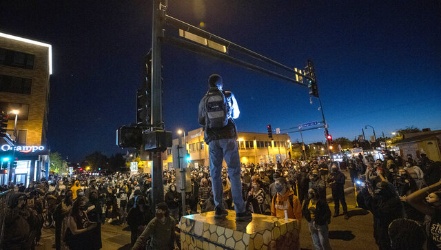 Protesters block an intersection in Minneapolis on Wednesday, Oct. 7, 2020, after Derek Chauvin, the former Minneapolis police officer charged with murder in the death of George Floyd, posted bail and was released from prison. (Carlos Gonzalez/Star Tribune via AP)