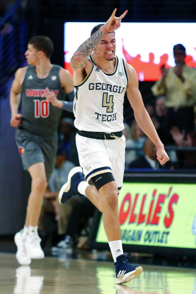 Georgia Tech guard Jordan Usher (4) reacts after scoring in the second half of an NCAA college basketball game against Louisville in Atlanta, Wednesday, Feb. 12, 2020. (AP Photo/Todd Kirkland)