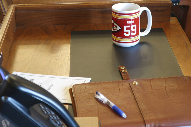 A Kansas City Chiefs coffee cup sits on the desk of Kansas House Speaker Pro Tem Blaine Finch, R-Ottawa, after the House's session, Monday, Feb. 3, 2020, at the Statehouse in Topeka, Kansas. Finch and other Kansas lawmakers cheered the team's victory. The