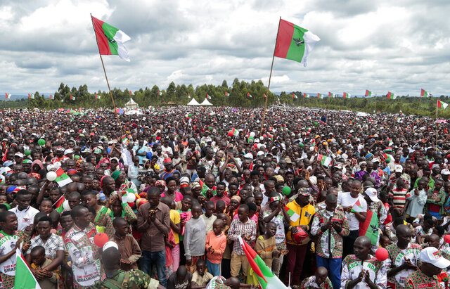 In this photo taken Monday, April 27, 2020, crowds of supporters of the ruling party gather for the start of the election campaign, in Bugendana, Gitega province, Burundi. Burundi is kicking out the World Health Organization's top official in the country Walter Kazadi Mulombo and three experts, saying they must leave by Friday, May 15, 2020, just days before the presidential election and after the WHO raised concerns about crowded political rallies which health officials say risk facilitating the spread of the coronavirus. (AP Photo/Berthier Mugiraneza)