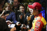 Joey Logano talks with reporters during NASCAR Daytona 500 auto racing media day at Daytona International Speedway, Wednesday, Feb. 12, 2020, in Daytona Beach, Fla. (AP Photo/John Raoux)