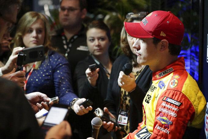 Joey Logano talks with reporters during NASCAR Daytona 500 auto racing media day at Daytona International Speedway, Wednesday, Feb. 12, 2020, in Daytona Beach, Fla. (AP Photo/John Raoux)