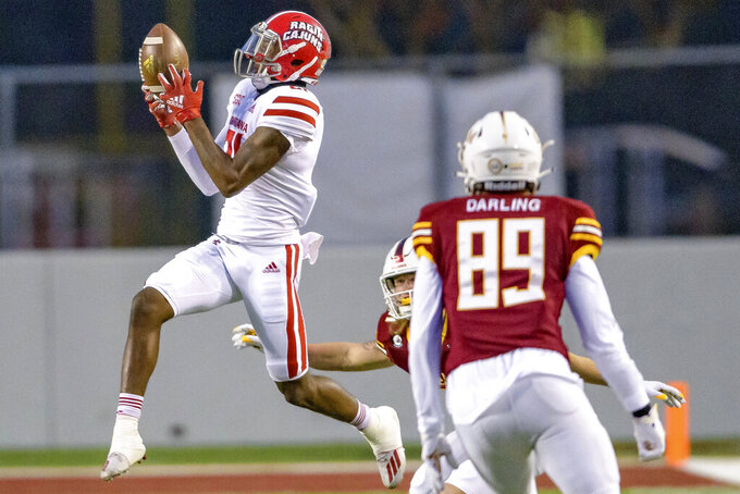 Louisiana-Lafayette cornerback Trey Amos (21) makes an interception in the second half of an NCAA college football game against Louisiana-Monroe in Monroe, La., Saturday, Nov. 28, 2020. (AP Photo/Matthew Hinton)