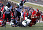 New Mexico quarterback Tevaka Tuioti (8) is sacked by Hawaii defensive lineman Blessman Ta'ala (55) during the first half of an NCAA college football game on Saturday, Oct. 26, 2019, in Albuquerque, N.M. (AP Photo/Andres Leighton)