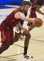 Cleveland Cavaliers' Kevin Love steals the ball during the first quarter of an NBA basketball game against the Orlando Magic Wednesday, April 28, 2021 in Cleveland. (AP Photo/Phil Long)