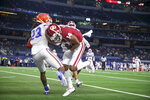 Oklahoma wide receiver Charleston Rambo (14) catches a touchdown pass over Florida defensive back Jaydon Hill (23) during the Goodyear Cotton Bowl between Oklahoma and Florida at AT&T Stadium in Arlington, Texas on Wednesday, Dec. 30, 2020.(Ian Maule/Tulsa World via AP)