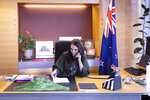 In this photo provided by New Zealand Prime Minister's Office, Prime Minister Jacinda Ardern talks with U.S. President-elect Joe Biden on phone at her office in Wellington, New Zealand, Monday, Nov. 23, 2020. Ardern became the latest world leader to congratulate Biden on his election victory Monday and says she offered to share her nation's expertise on dealing the coronavirus. (New Zealand Prime Minister's Office via AP)