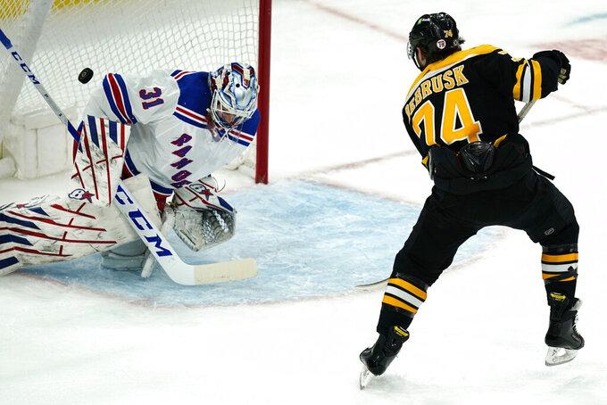 Boston Bruins left wing Jake DeBrusk (74) scores against New York Rangers goaltender Igor Shesterkin (31) on a breakaway in the second period of an NHL hockey game, Thursday, May 6, 2021, in Boston. (AP Photo/Elise Amendola)