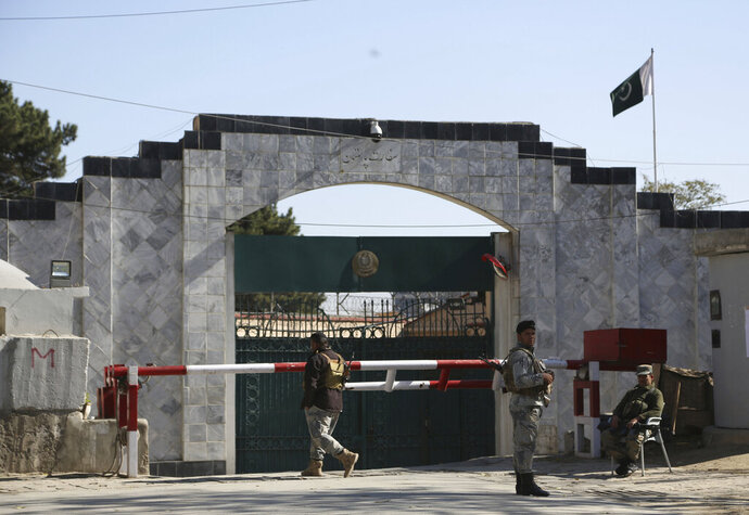 Security stands guard outside the Pakistan Embassy in Kabul, Afghanistan, Monday, Nov. 4, 2019. The Pakistan Embassy issued a statement announcing the indefinite closure of their consular services, citing unspecified security concerns.. (AP Photo/Rahmat Gul)