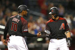 Arizona Diamondbacks' Nick Ahmed celebrates with Adam Jones (10) after hitting a two-run home run against the San Francisco Giants in the eighth inning during a baseball game, Saturday, Aug. 17, 2019, in Phoenix. (AP Photo/Rick Scuteri)