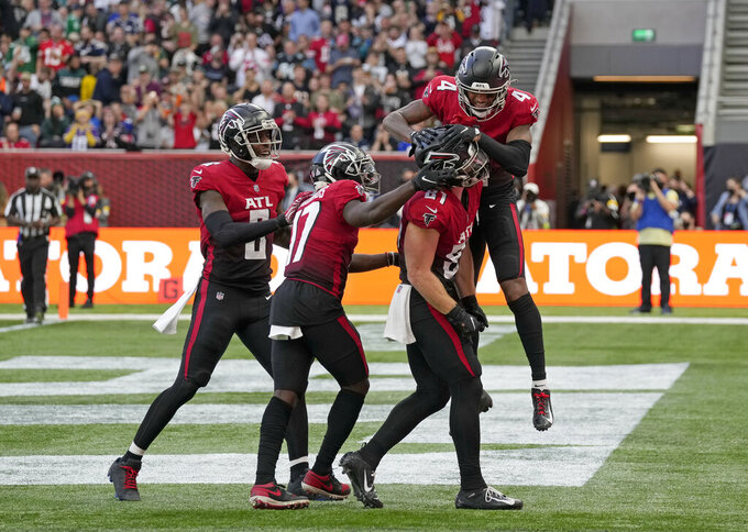 Atlanta Falcons tight end Hayden Hurst (81), bottom right, celebrates after scoring a touchdown during the first half of an NFL football game between the New York Jets and the Atlanta Falcons at the Tottenham Hotspur stadium in London, England, Sunday, Oct. 10, 2021. (AP Photo/Alastair Grant)