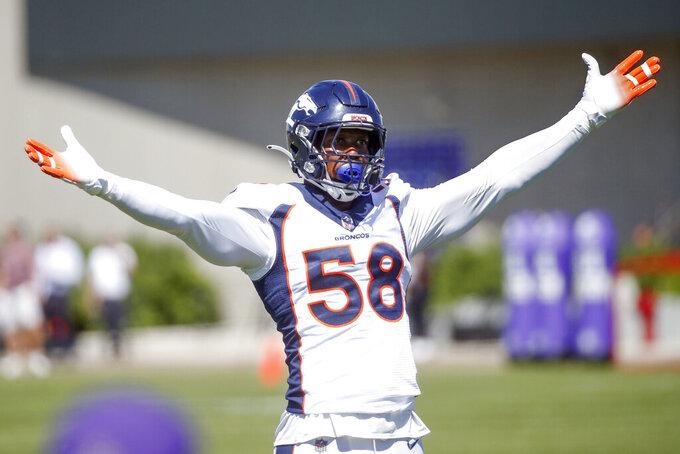 Denver Broncos linebacker Von Miller leads Minnesota Vikings fans in a cheer during a joint NFL football training camp Thursday, Aug. 12, 2021, in Eagan, Minn. (AP Photo/Bruce Kluckhohn)