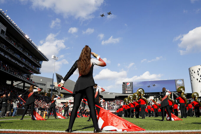 Fighter jets fly over Nippert Stadium during the national anthem before an NCAA college football game between Cincinnati and Navy, Saturday, Nov. 3, 2018, in Cincinnati. (AP Photo/John Minchillo)