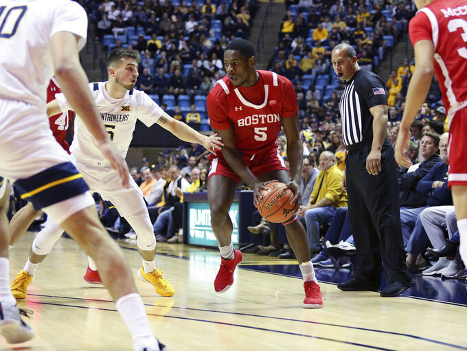 West Virginia's Jordan McCabe, back left, defends against Boston University guard Walter Whyte during the first half of an NCAA college basketball game Friday, Nov. 22, 2019, in Morgantown, W.Va. (AP Photo/Kathleen Batten)