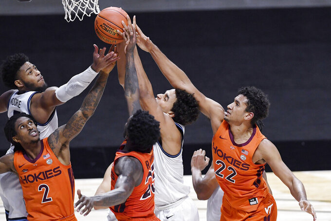 Virginia Tech and Villanova players vie for a rebound in the second half of an NCAA college basketball game, Saturday, Nov. 28, 2020, in Uncasville, Conn. (AP Photo/Jessica Hill)