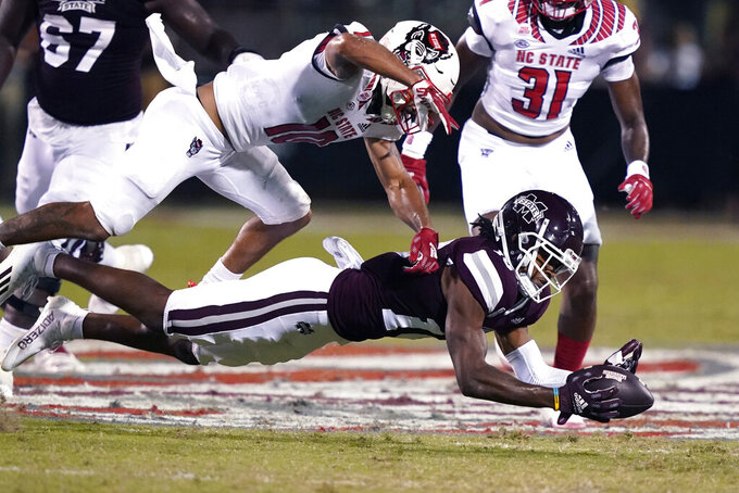 Mississippi State wide receiver Makai Polk (10) reaches for a pass as North Carolina State safety Tanner Ingle (10) defends over him during the first half of an NCAA college football game in Starkville, Miss., Saturday, Sept. 11, 2021. The pass was ruled incomplete. (AP Photo/Rogelio V. Solis)