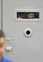 Jacksonville Jaguars cornerback Jalen Ramsey looks out from the back of an armored car before comedian Ha Ha Davis, not shown, announced his arrival to NFL football training camp outside TIAA Bank Field in Jacksonville, Fla., Wednesday, July 24, 2019. (Bob Self/The Florida Times-Union via AP)