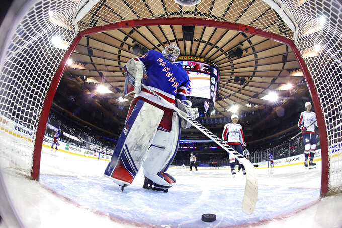 New York Rangers' Alexandar Georgiev takes the puck from the net following a second-period goal by Washington Capitals' T.J. Oshie (77) during an NHL hockey game Wednesday, May 5, 2021, in New York. (Bruce Bennett/Pool Photo via AP)