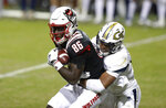 North Carolina State wide receiver Emeka Emezie (86) pulls in a reception as Georgia Tech defensive back Wesley Walker (39) defends during the second half  of an NCAA college football game in Raleigh, N.C., Saturday, Dec. 5, 2020. (Ethan Hyman/The News & Observer via AP, Pool)