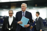European Union chief Brexit negotiator Michel Barnier arrives for a debate on a proposed mandate for negotiations for a new partnership with the United Kingdom of Great Britain and Northern Ireland, at the European Parliament in Strasbourg, eastern France, Tuesday, Feb.11, 2020. (AP Photo/Jean-Francois Badias)