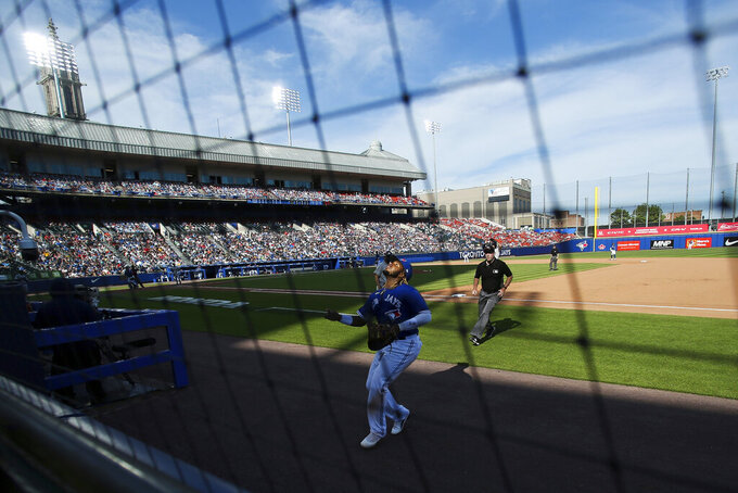 Toronto Blue Jays' first baseman Vladimir Guerrero Jr. (27) tracks a foul ball hit by Houston Astros' Jose Altuve (27) during the eighth inning of a baseball game in Buffalo, N.Y., Saturday, June 5, 2021. (AP Photo/Joshua Bessex)