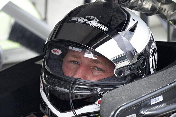 Jeffrey Earnhardt sits in his car before the restart of a NASCAR Xfinity Series auto race at Daytona International Speedway, Saturday, Aug. 28, 2021, in Daytona Beach, Fla. (AP Photo/Phelan M. Ebenhack)
