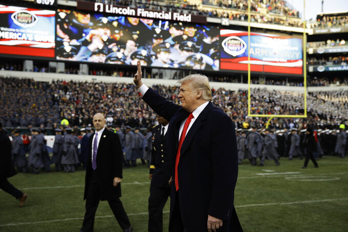 President Donald Trump waves to attendees ahead of an NCAA college football game between Army and Navy, Saturday, Dec. 8, 2018, in Philadelphia. (AP Photo/Matt Rourke)