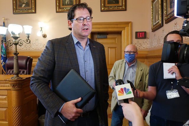 Kansas House Speaker Ron Ryckman Jr., R-Olathe, speaks with reporters following a meeting of legisative leaders with Democratic Gov. Laura Kelly, Friday, June 26, 2020, at the Statehouse in Topeka, Kan. Ryckman says a plan from Kelly to erase a budget shortfall that arose amid the coronavirus pandemic merely pushes the state's financial problems off a year. (AP Photo/John Hanna)