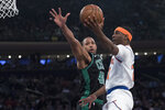 New York Knicks guard Damyean Dotson (21) goes to the basket against Boston Celtics center Al Horford (42) during the first half of an NBA basketball game Friday, Feb. 1, 2019, at Madison Square Garden in New York. (AP Photo/Mary Altaffer)