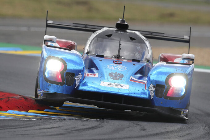 The BR Engineering No11 of the SMP Racing Team driven by Vitaly Petrov of Russia, Mikhail Aleshin of Russia and Stoffel Vandoorne of Belgium races during the 87th 24-hour Le Mans endurance race, in Le Mans, western France, Sunday, June 16, 2019. (AP Photo/David Vincent)