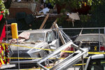Damaged cars sit in front of an apartment building Monday Sept. 13, 2021 in Dunwoody, Ga., just outside of Atlanta, following an explosion Sunday. (AP Photo/Ben Gray)