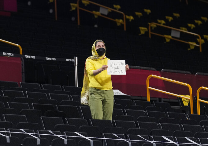 An Iran fan displays a paper during men's basketball game between Czech Republic and Iran at the 2020 Summer Olympics, Sunday, July 25, 2021, in Saitama, Japan. (AP Photo/Eric Gay)
