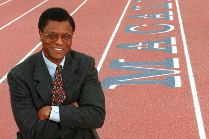 Irv Cross poses at Macalester College in St. Paul, Minn., in this April 8, 1999, file photo. Cross, the former NFL defensive back who became the first Black man to work full-time as a sports analyst on national television, died Sunday, Feb. 28, 2021. He was 81. The Philadelphia Eagles, the team Cross spent six of his nine NFL seasons with, said Cross' son, Matthew, confirmed his father died near his home in Roseville, Minnesota. The cause of death was not provided. (Ann Heisenfelt/Star Tribune via AP)