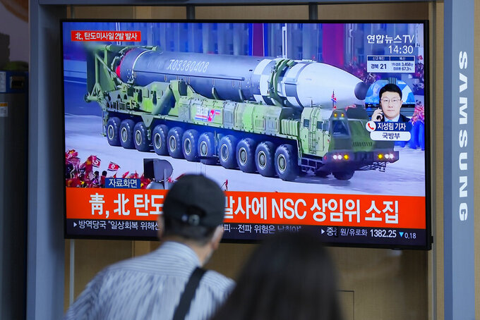 """People watch a TV screen showing a news program reporting about North Korea's missiles with file footage in Seoul, South Korea, Wednesday, Sept. 15, 2021. North Korea fired two ballistic missiles into waters off its eastern coast Wednesday afternoon, two days after claiming to have tested a newly developed missile in a resumption of its weapons displays after a six-month lull. The letters read """"North Korea fired two ballistic missiles."""" (AP Photo/Lee Jin-man)"""